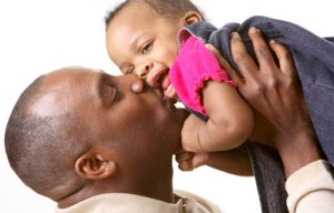 african_amer_dad_kiss_baby
